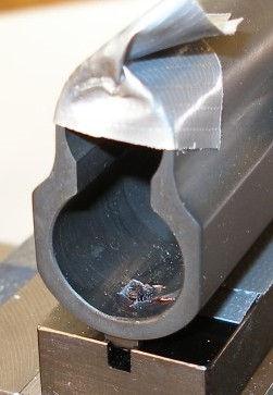 View of a swaged front sight as it sits in teh jig.